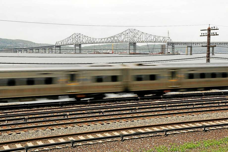 (AP Photo/Julie Jacobson)  A Metro-North train streaks along the Hudson River just south of the Tappan Zee Bridge in Tarrytown, N.Y. Photo: AP Photo/Julie Jacobson / AP