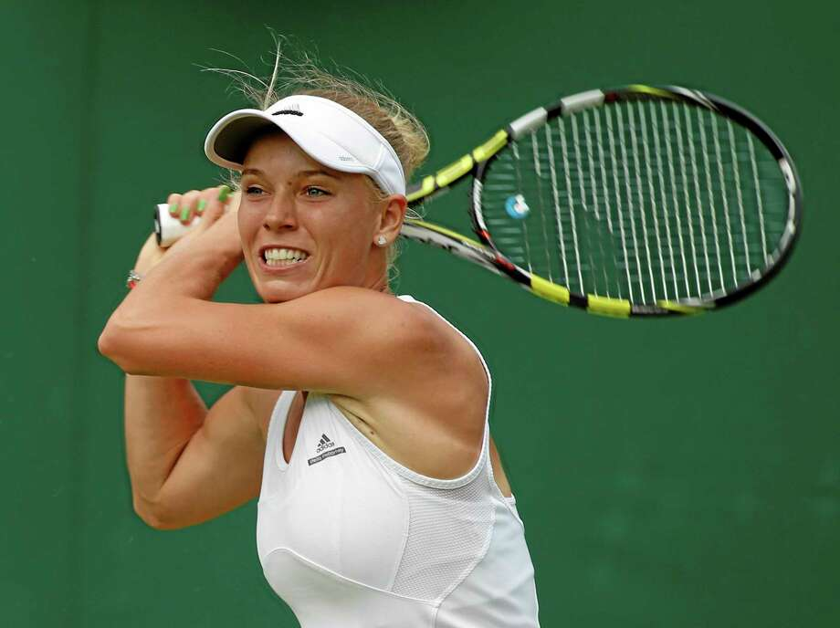 Caroline Wozniacki plans to play a full tournament schedule this fall while fitting in time to train for the New York City Marathon. The former No. 1 player said Thursday that she long had wanted to do a marathon and decided before Wimbledon that she could pull it off this year. Photo: Alastair Grant — The Associated Press File Photo   / AP