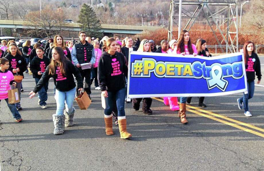 Youths from Seymour Pink march in the Seymour Christmas Parade Sunday. Photo: Kate Ramunni -- New Haven Register
