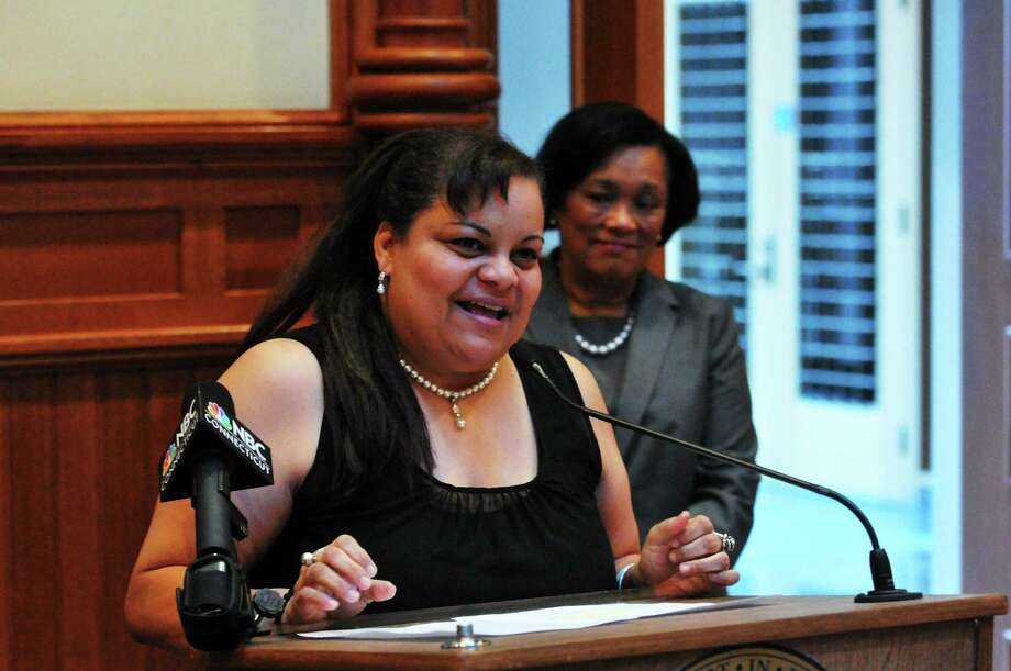 New Haven Mayor Toni Harp, rear, announces the city's new elderly services director, Migdalia Castro, during a press conference at City Hall Friday. Photo: Peter Casolino — New Haven Register