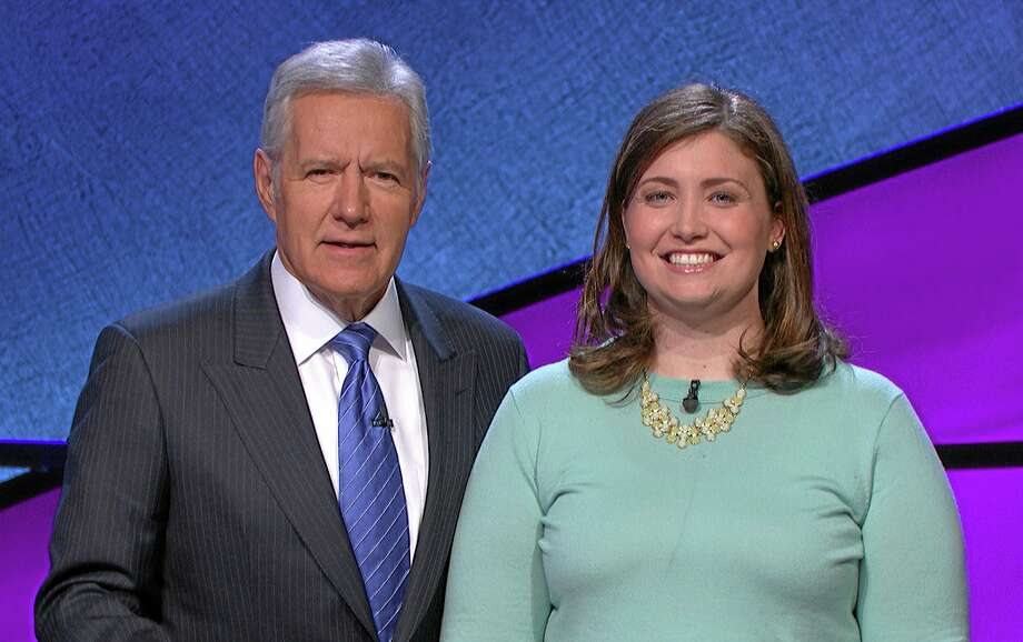 """In this January 2014 photo provided by Jeopardy Productions, Inc., shows Alex Trebek, host of the TV show """"Jeopardy!,"""" poses with contestant Julia Collins, 31, of Kenilworth, Ill., during the taping of her shows on stage at JEOPARDY!, Sony Pictures Studios, Culver City, Calif. On a show that aired Tuesday, May 27, 2014, Collins won her 17th straight game on Jeopardy! and has won more games than all but two other contestants in the history of the show. (AP Photo/Courtesy of Jeopardy Productions, Inc.) Photo: AP / Jeopardy Productions, Inc."""