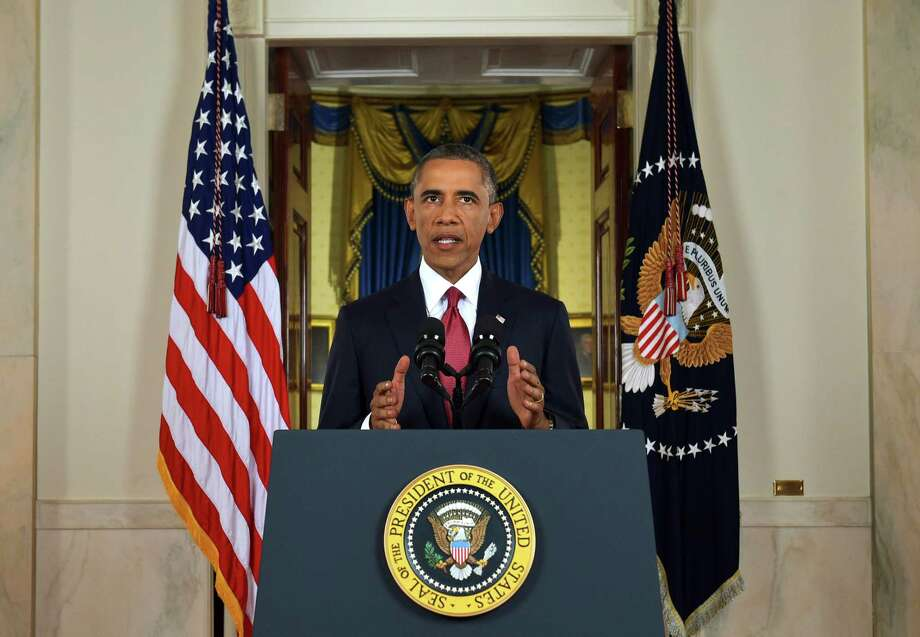In this AP file photo, President Barack Obama addresses the nation from the Cross Hall in the White House in Washington, Wednesday, Sept. 10, 2014. In a major reversal, Obama ordered the United States into a broad military campaign to ìdegrade and ultimately destroyî militants in two volatile Middle East nations, authorizing airstrikes inside Syria for the first time, as well as an expansion of strikes in Iraq. Photo:  (AP Photo/Saul Loeb, Pool) / Pool AFP