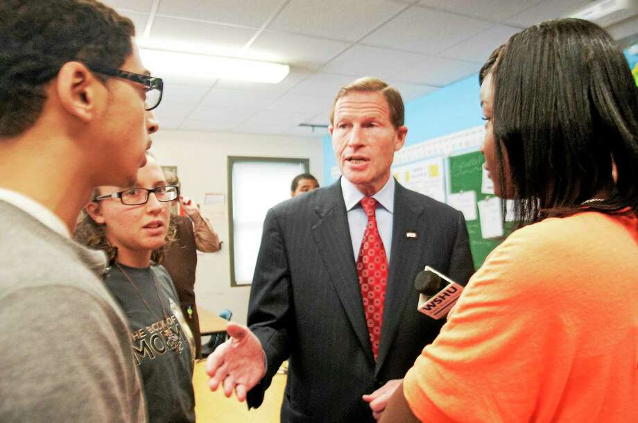 U.S. Sen. Richard Blumenthal talks with Common Ground High School students, from left, Harry Barbosa, Miranda Bailey-Russomano and Nariah Odems after meeting with students to discuss gun violence Monday in New Haven. Photo: Melanie Stengel — New Haven Register      / PETER HVIZDAK