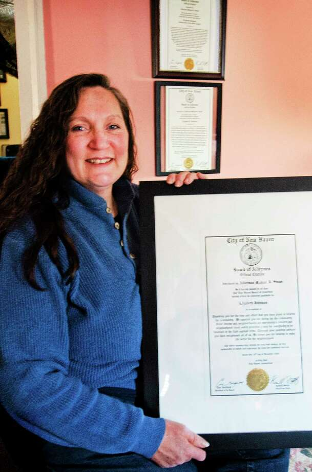 (Melanie Stengel ÇƒÓ New Haven Register)   Volunteer, Beth Johnson, of New Haven, with some of her many awards 1/22. Photo: Journal Register Co.