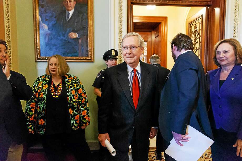 Senate Minority Leader Mitch McConnell, R-Ky., center, joined by Sen. Deb Fischer, R-Neb., far right, outside the U.S. Senate chamber. Photo: AP Photo/J. Scott Applewhite   / AP