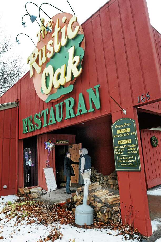 The Rustic Oak restaurant in North Haven has closed its doors. Owners, staff and friends spent a last day at the restaurant Monday. Photo: Mara Lavitt — New Haven Register      / Mara Lavitt