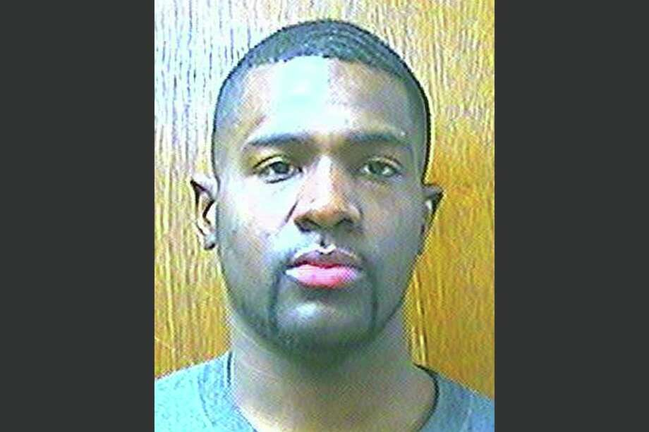 FILE - This March 25, 2013, file photo provided by the Oklahoma Department of Corrections shows Alton Nolen of Moore, Okla. Nolen was charged Tuesday, Sept. 30, 2014, with first-degree murder in the gruesome beheading of a Vaughan Foods worker, authorities said. (AP Photo/Oklahoma Department of Corrections, File) Photo: AP / Oklahoma Department of Corrections