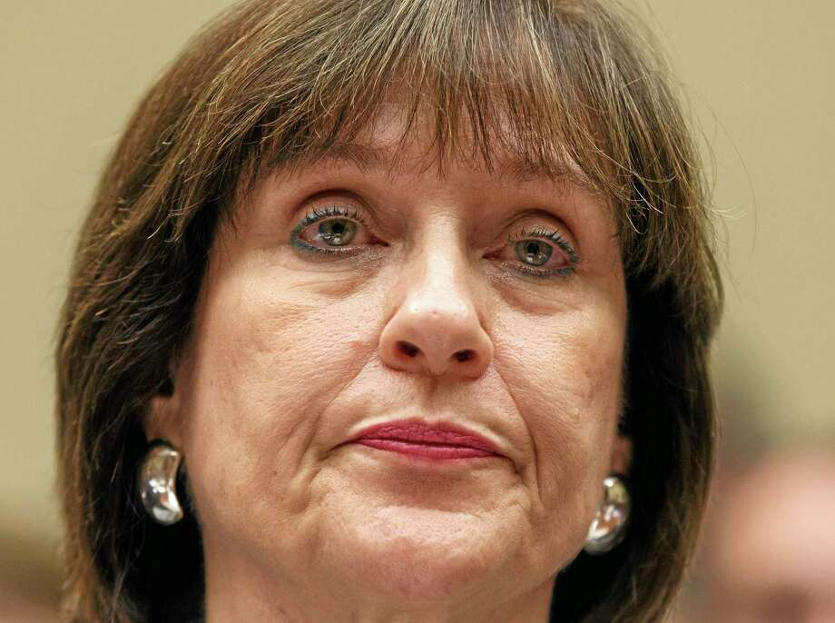 "FILE - In this May 22, 2013 file photo, Internal Revenue Service official Lois Lerner refuses to answer questions as the House Oversight Committee holds a hearing to investigate the extra scrutiny the IRS gave Tea Party and other conservative groups that applied for tax-exempt status, on Capitol Hill in Washington. Lerner, a former IRS official at the heart of the agency's tea party controversial called Republicans ""crazies"" and more in newly released emails. Lerner used to head the IRS division that handles applications for tax-exempt status. In a series of emails with a colleague in November 2012, Lerner made two disparaging remarks about members of the GOP, including one remark that was profane. House Ways and Means Committee Chairman Rep. Dave Camp, R-Mich., released the emails Wednesday as part of his committee's investigation. Camp says the emails show Lerner's disgust with conservatives. (AP Photo/J. Scott Applewhite, File) Photo: AP / AP"