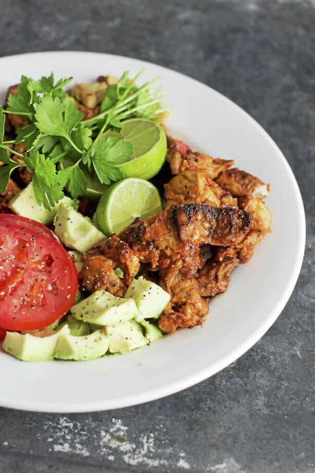 Spicy Peanut-Chicken Satay can be made in about 25 minutes. Photo: Matthew Mead — The Associated Press    / FR170582 AP