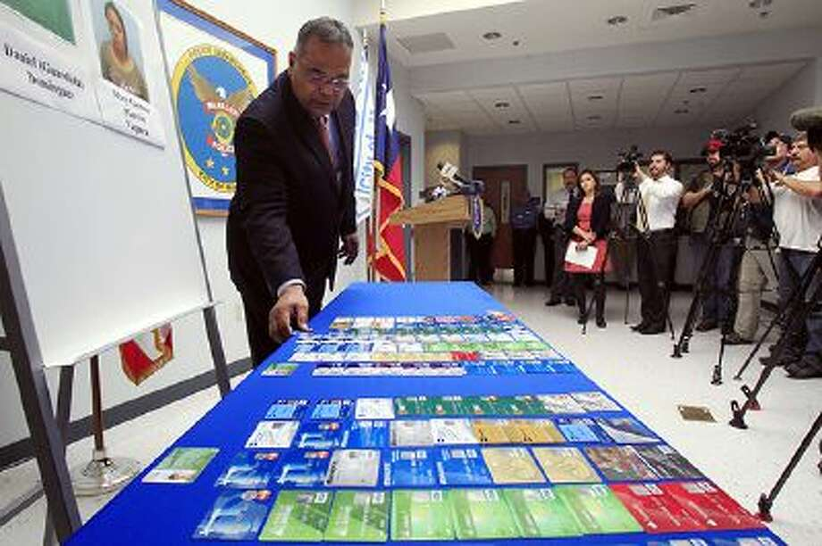 McAllen Police Chief Victor Rodriguez displays dozens of fraudulent credit cards that were confiscated by McAllen police after arresting a man and a woman on fraud charges tied to the December Target credit card breach, Monday Jan. 20, 2014 at the McAllen Police Department in McAllen, Texas. Photo: AP / The Monitor