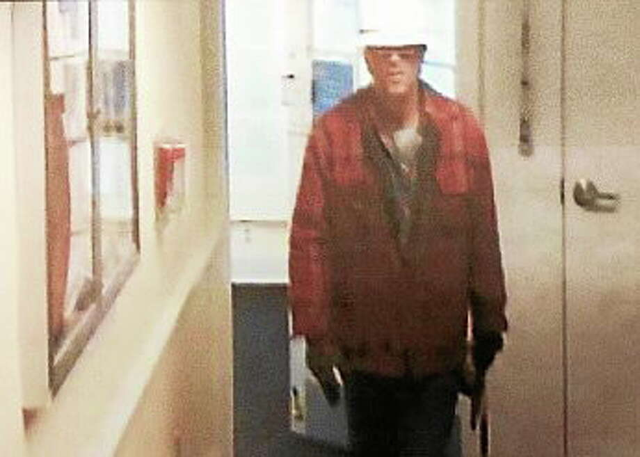 Police say surveillance footage from a Milford Bank branch on Bridgeport Avenue shows the suspect in a January robbery. Police have now identified him as John Dearborn, of Manchester, charging him with first-degree robbery, second-degree larceny and first-degree breach of peace. Photo: Contributed Photo — Milford Police Department