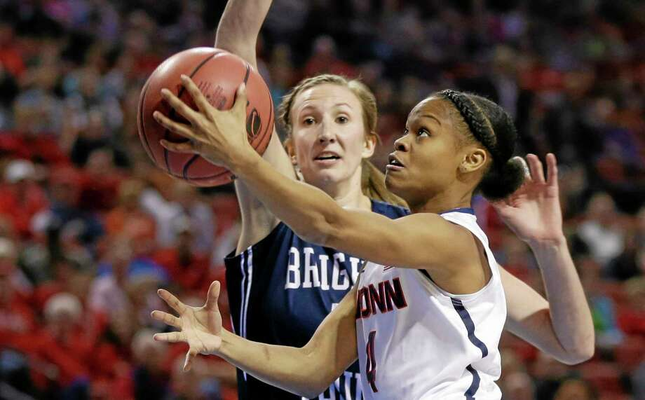 UConn's Moriah Jefferson (4) goes for a layup against BYU's Jennifer Hamson on Saturday. Photo: Nati Harnik — The Associated Press   / AP