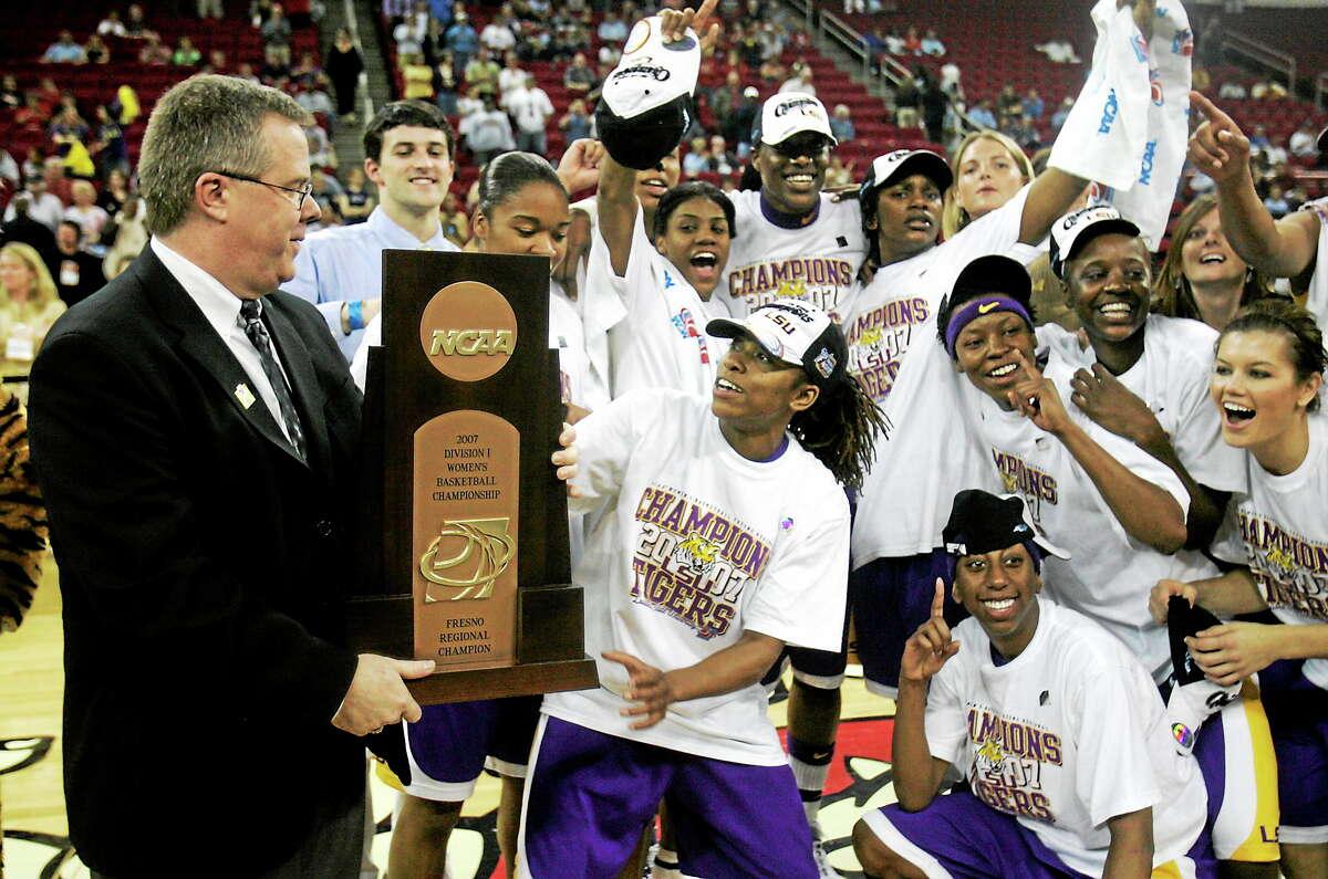 Bob Starkey, who was the LSU interim coach at the time, celebrates with his team after they beat UConn in the 2007 Fresno Regional final in the NCAA tournament.