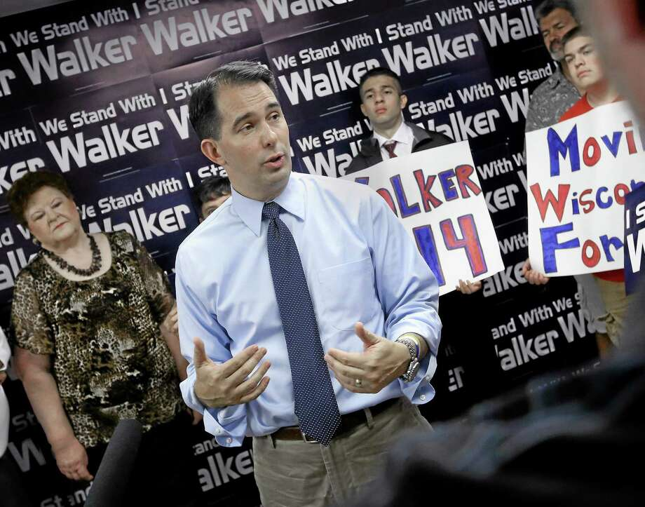 Wisconsin Gov. Scott Walker addresses members of the media and volunteers with the state's Republican Party during a stop at the Madison GOP field office in Madison, Wis., Wednesday, July 23, 2014. (AP Photo/Wisconsin State Journal, John Hart) Photo: AP / Wisconsin State Journal