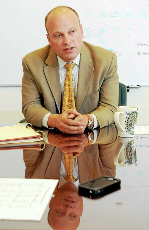 (Peter Hvizdak - New Haven Register)  Garth Harries, New Haven Superintendent of Schools, in his office Friday, May 30, 2014, addressing budget gap concerns. Photo: New Haven Register / ©Peter Hvizdak /  New Haven Register