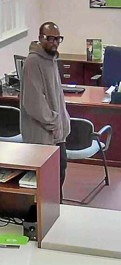 A surveillance photo from TD Bank, 128 Amity Road, shows a man police say robbed the bank on Tuesday. Photo: Contributed Photo — Woodbridge Police