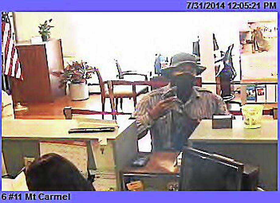A surveillance photo shows a man police said robbed the First Niagara Bank branch on Whitney Avenue on Thursday. Photo: Contributed Photo — Hamden Police Department