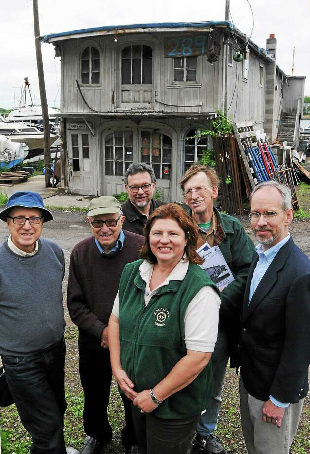 Among those trying to renovate a dilapidated oyster barge on Front Street in New Haven are, from left, brothers Joseph and John Kochiss of Trumbull, John Herzan of the New Haven Preservation Trust, Lisa Fitch, owner of the Quinnipiac River Marina, Ken Karl of Terryville and Christopher Wigren of the Connecticut Trust for Historic Preservation. Photo: Mara Lavitt — New Haven Register     / Mara Lavitt