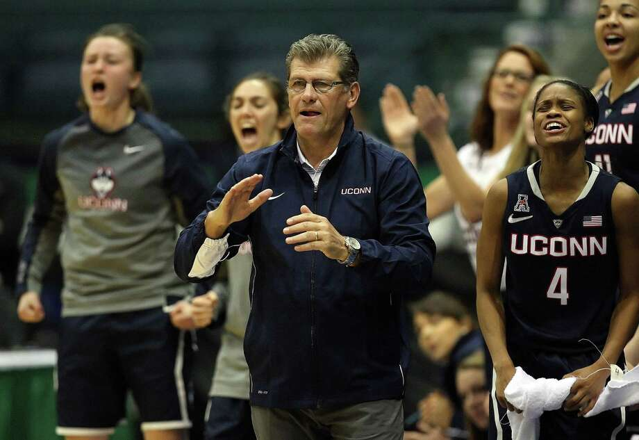 UConn head coach Geno Auriemma celebrates a score against Vanderbilt during the first half Saturday. Photo: Kinfay Moroti — The Associated Press    / The News-Press