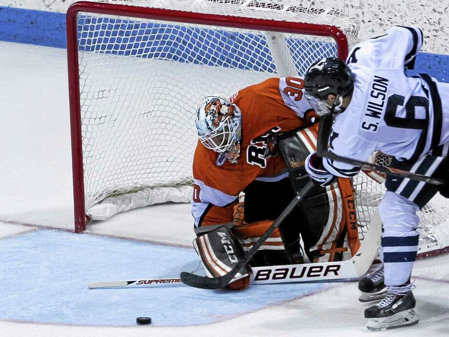 Yale's Stu Wilson takes a shot during the Bulldogs' 2-0 win over RIT on Saturday. Photo: Steve Musco — Submitted Photo   / Steve Musco