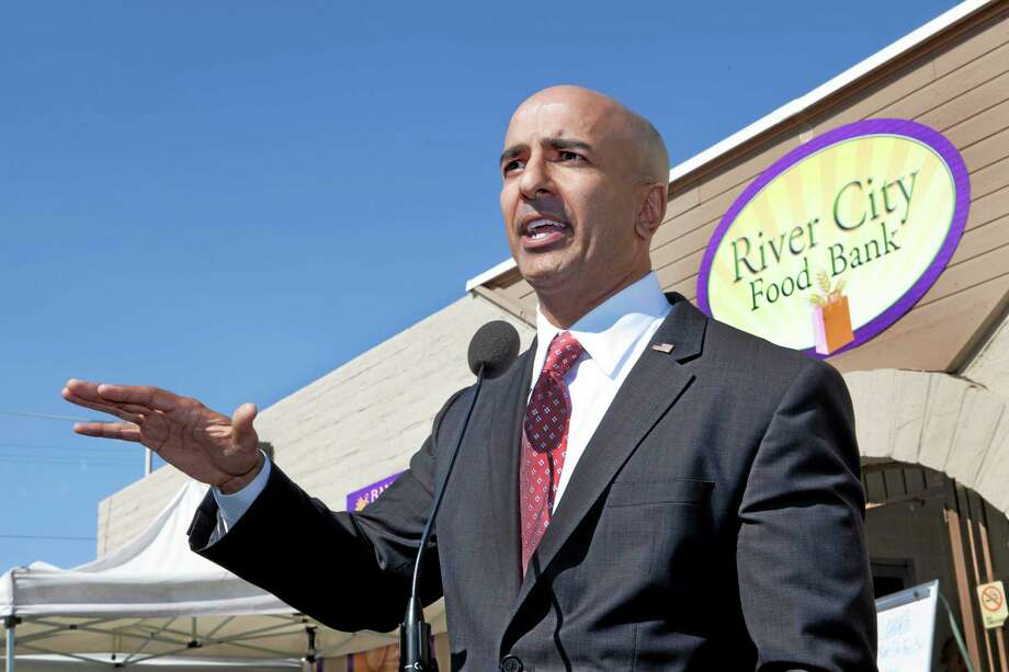 Republican candidate for governor Neel Kashkari discusses issues related to poverty in California during a news conference outside of the River City Food Bank in Sacramento, Calif., on Thursday, July 31, 2014. Kashkari said he spent a week living as a homeless person in search of a job to test Gov. Jerry Brown's claim that the state is making a comeback after the economic downturn. A video crew documented his week. (AP Photo/Steve Yeater) Photo: AP / FR69238 AP