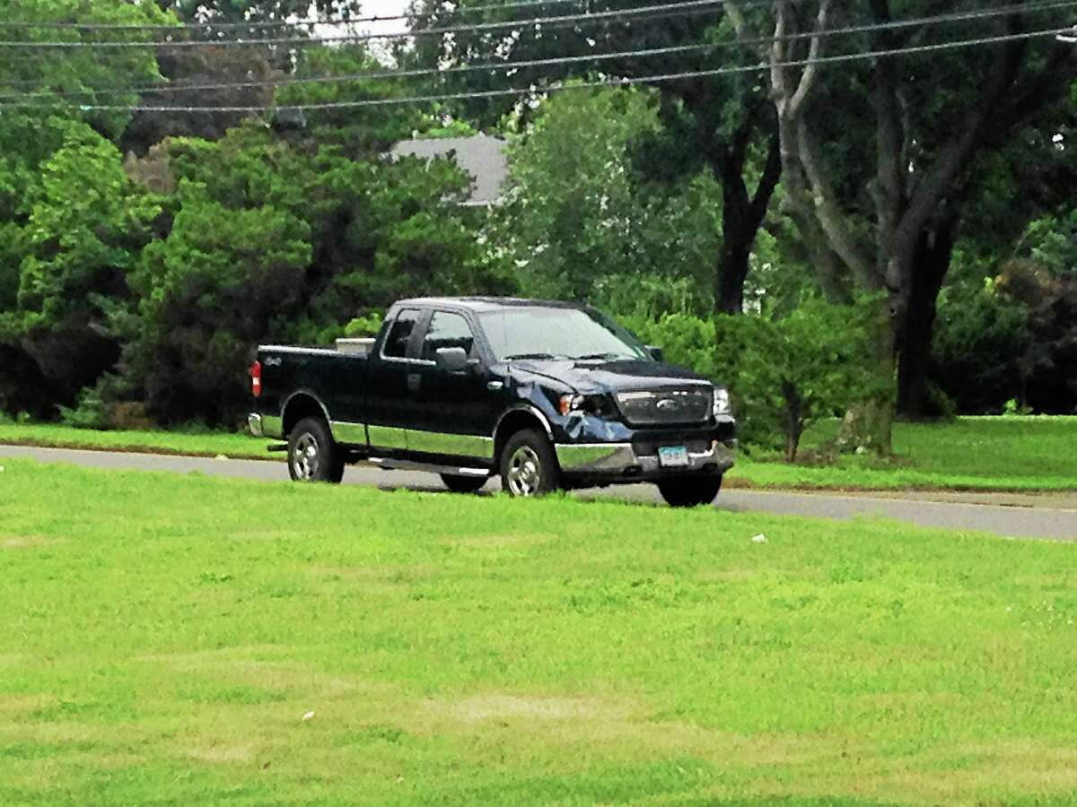 A pickup truck police said was driven by Theodore Spalding, 72, at the scene of an accident in North Haven on Middletown Avenue on July 16. John Liquori, 20, was struck by the truck and killed, police said.