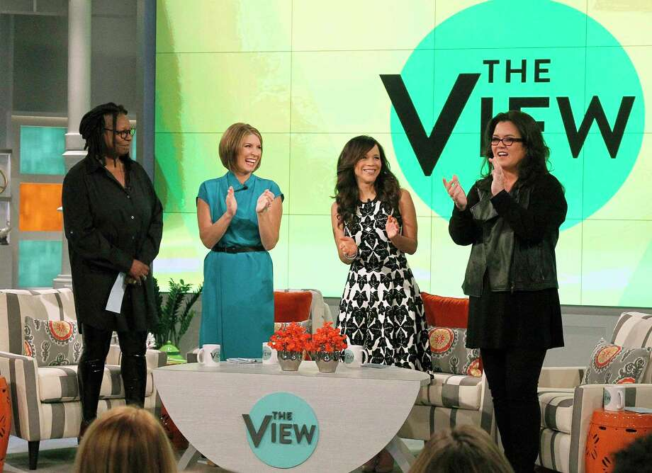 """In this image released by ABC,  co-hosts, from left, Whoopi Goldberg, Nicolle Wallace, Rosie Perez and Rosie O'Donnell appear on the set of the daytime talk show """"The View,"""" on Monday, Sept. 15, 2014 in New York. (AP Photo/ABC, Lou Rocco) Photo: AP / American Broadcasting Companies,"""