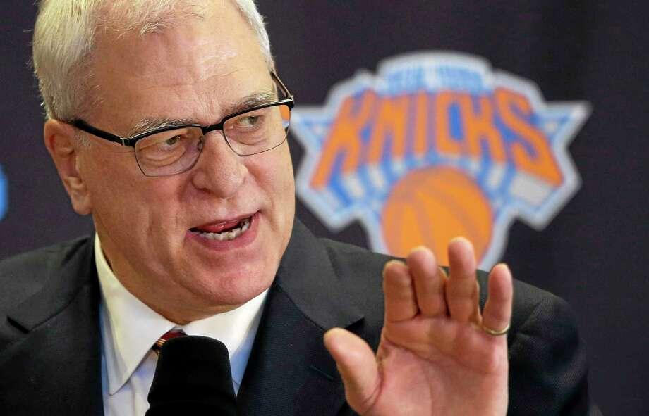 Knicks president Phil Jackson has asked star forward Carmelo Anthony to delay free agency. Photo: Mark Lennihan — The Associated Press   / AP