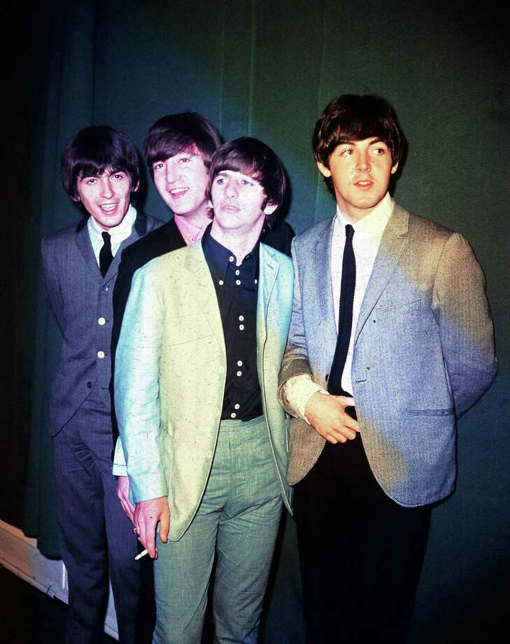 FILE - This 1964 file photo shows the British rock and roll group, the Beatles, from left, George Harrison, John Lennon, Ringo Starr and Paul McCartney, during their first U.S. tour. McCartney and Starr will attend the Recording Academy's Special Merit Awards ceremony, on Saturday, Jan. 25, 2014, where the Beatles will be honored with a lifetime achievement award, in Los Angeles. (AP Photo, File) Photo: AP / A1964
