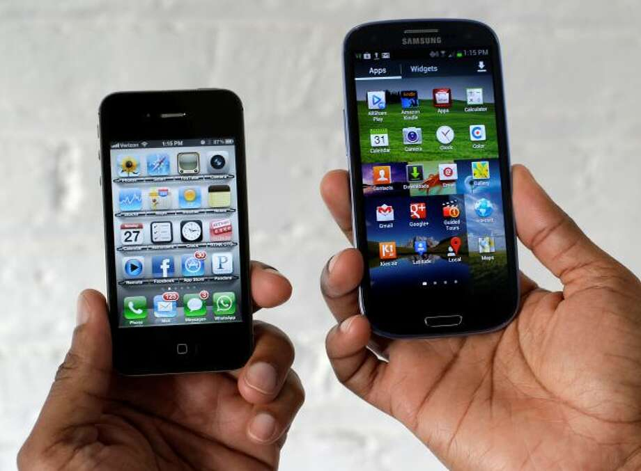 In this Aug. 27, 2012 photo, the Apple iPhone 4s, left, is displayed next to the Samsung Galaxy S III at a store in San Francisco. Apple already has won nearly $1 billion in judgments against Samsung over patent infringements involving older-model devices. Now Apple is alleging Samsung's newest devices, such as its Galaxy S III, also copied Apple technology. Jury selection for the case begins Monday, March 31, 2014. (AP Photo/Marcio Jose Sanchez) Photo: AP / AP