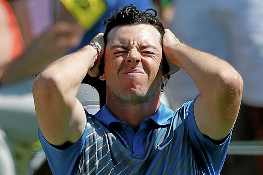 Rory McIlroy reacts after a bogey on the 18th hole at the Memorial in Dublin, Ohio, on Friday. Photo: Adam Cairns — The Columbus Dispatch   / The Columbus Dispatch