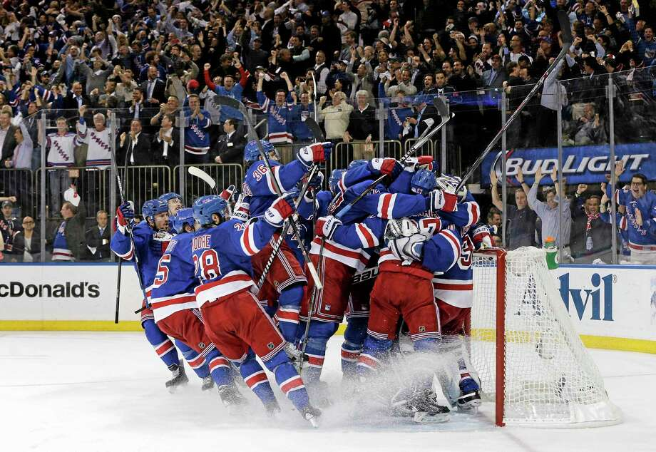 The Rangers celebrate after beating the Montreal Canadiens 1-0 in Game 6 of the Eastern Conference finals on Thursday in New York. Photo: Julie Jacobson — The Associated Press   / AP