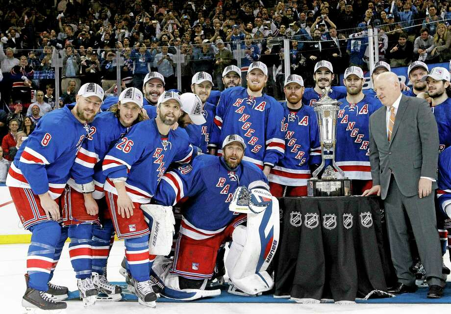 The Rangers pose for a photo with the Prince of Wales Trophy after beating the Montreal Canadiens 1-0 in Game 6 of the Eastern Conference finals on Thursday in New York. Photo: Kathy Willens — The Associated Press   / AP