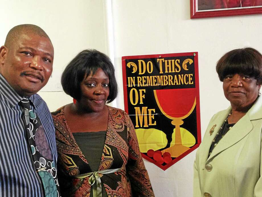 From left, the Rev. Philip Blamo, Tanya Blamo and Victoria Edwards of the Holiness Church of Jesus Christ in New Haven. Photo: ED STANNARD — NEW HAVEN REGISTER