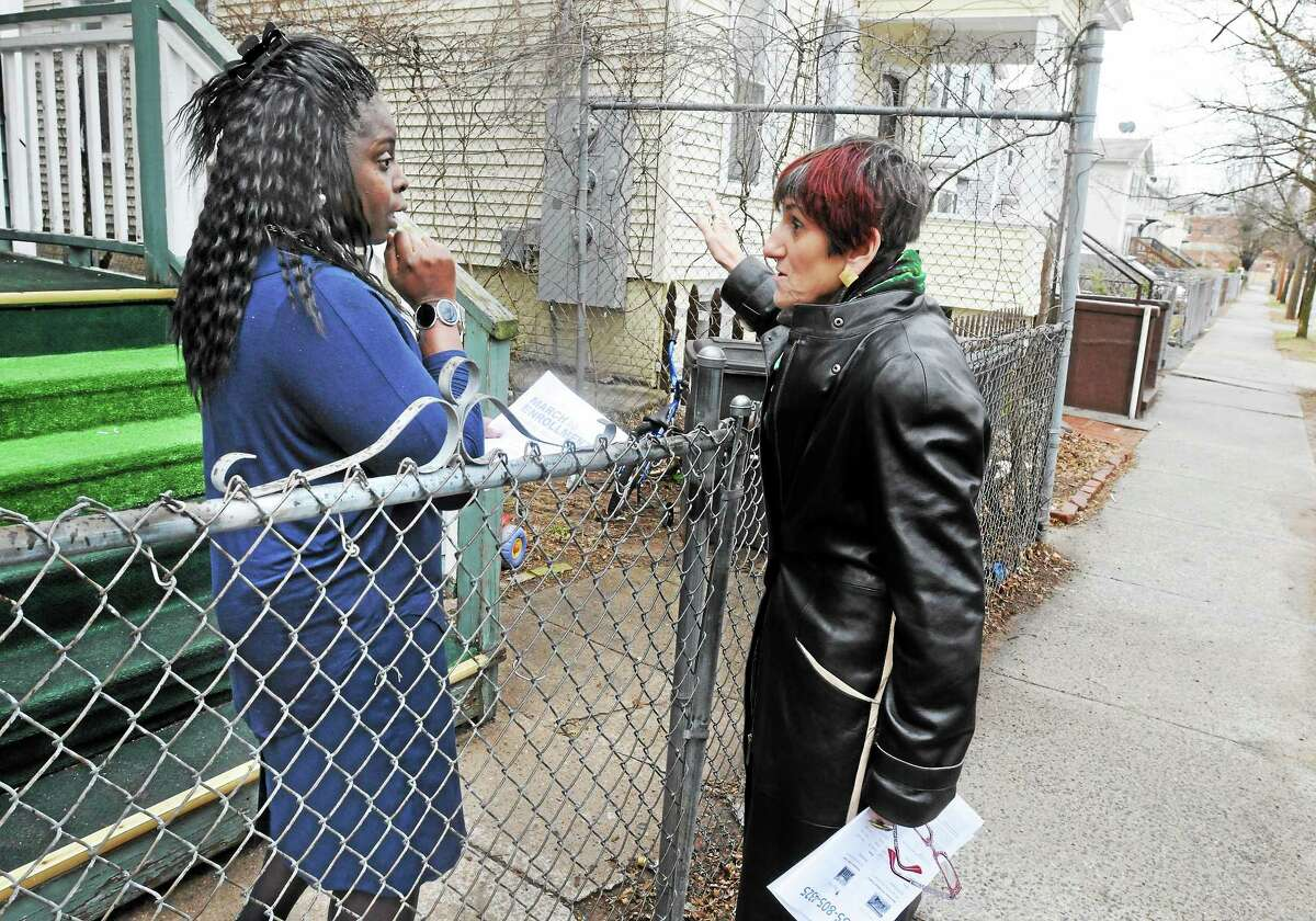 U.S. Rep. Rosa DeLauro, D-3, talks to Gwendolyn Willett of New Have about health care Sunday. DeLauro went to the Cornell Scott Hill Health Center in New Haven and canvassed for folks needing to sign up for health care before the deadline.
