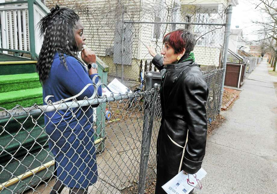 U.S. Rep. Rosa DeLauro, D-3, talks to Gwendolyn Willett of New Have about health care Sunday. DeLauro went to the Cornell Scott Hill Health Center in New Haven and canvassed for folks needing to sign up for health care before the deadline. Photo: (Mara Lavitt - New Haven Register)    / Mara Lavitt
