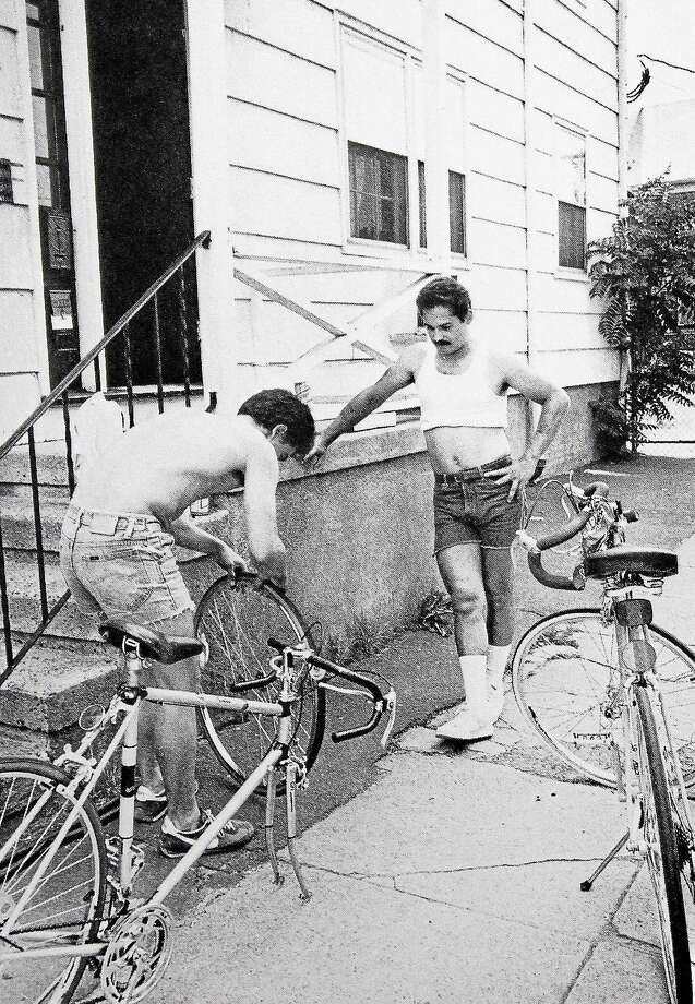 A dive into the annals of the Register indicates that the fight for commuter cyclistsí rights to the road started to surface during the mid-1980s. Here, two Dwight residents work on fixing a tire in a photo taken in 1982 for a New Haven city guide. Photo: Journal Register Co.
