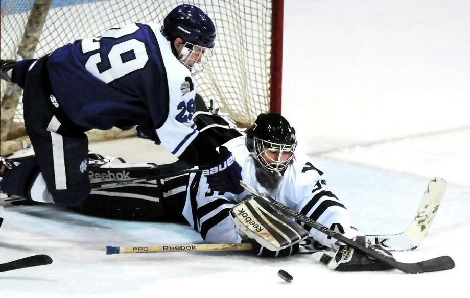 Yale goalie Alex Lyon makes a save against Holy Cross earlier this season. Photo: Mara Lavitt — Register   / Mara Lavitt
