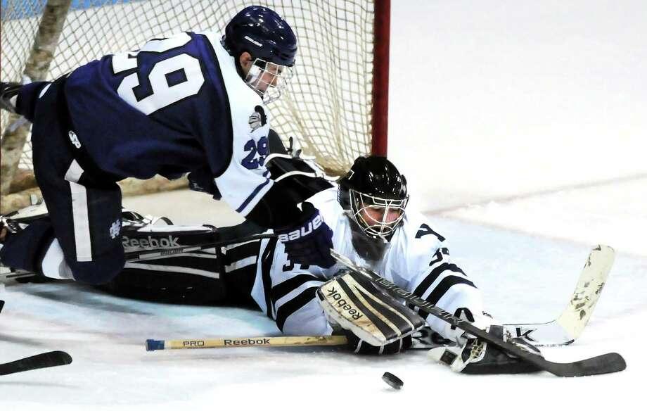Yale goalie Alex Lyon makes a save against Holy Cross earlier this season. Photo: Mara Lavitt — Register   / Mara Lavitt