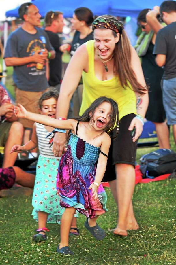 "The Gathering of the Vibes music festival in Bridgeport kicked off Thursday, and offers free admission for children under 12. Sunday will be ""Connecticut Family Day,"" with state residents saving $10 on tickets and kids 15 and under admitted free. Photo: Melanie Stengel — New Haven Register"