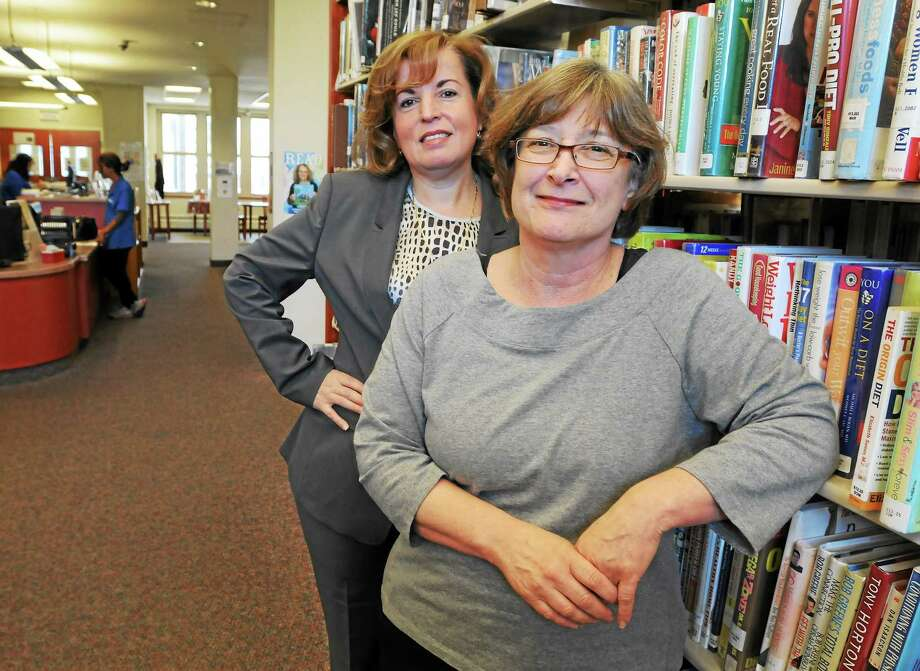 West Haven Library Director Kathy Giotsas, left, and Assistant Director Claudia Volano Thursday, May 29, 2014. Photo: Peter Hvizdak - New Haven Register   / ©Peter Hvizdak /  New Haven Register