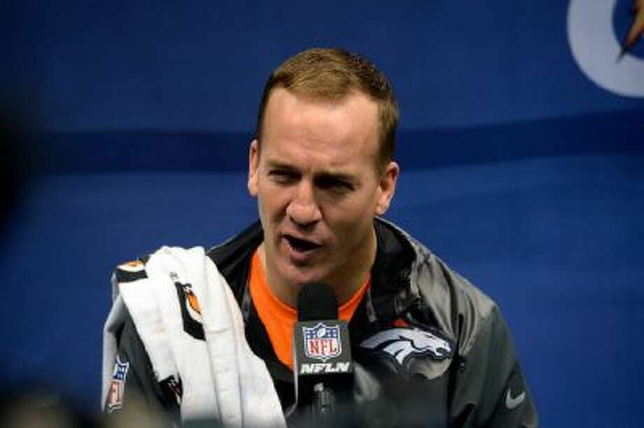Denver Broncos quarterback Peyton Manning (18) answers questions during the teams Media Day January 28, 2014 at the Prudential Center.