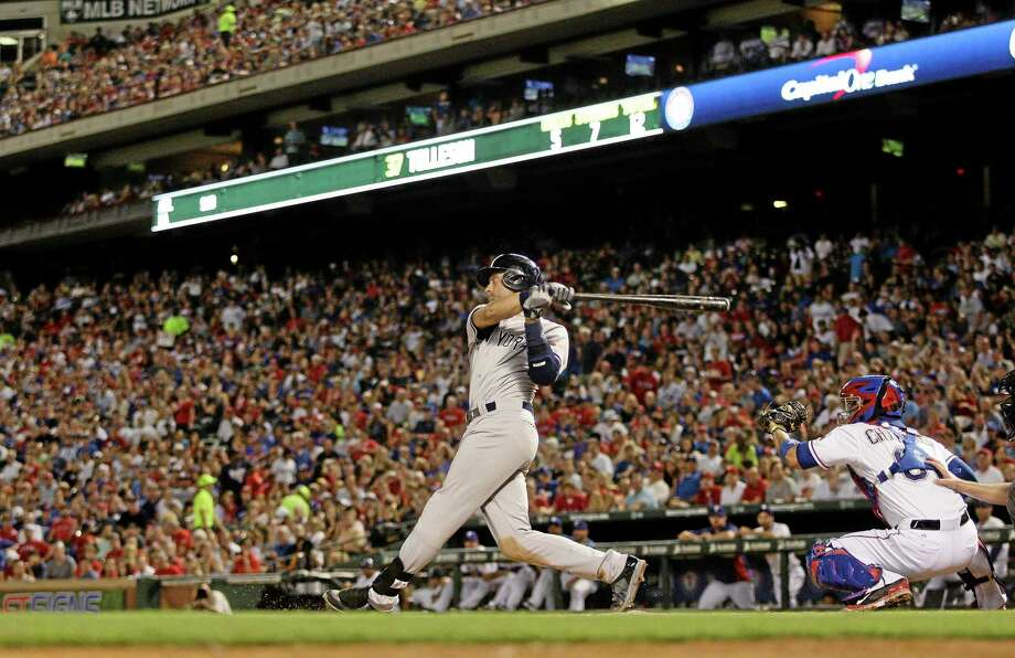 The Yankees' Derek Jeter hits a single in the sixth inning of Tuesday's game with the Rangers. Photo: Ralph Lauer — The Associated Press   / FR52694 AP