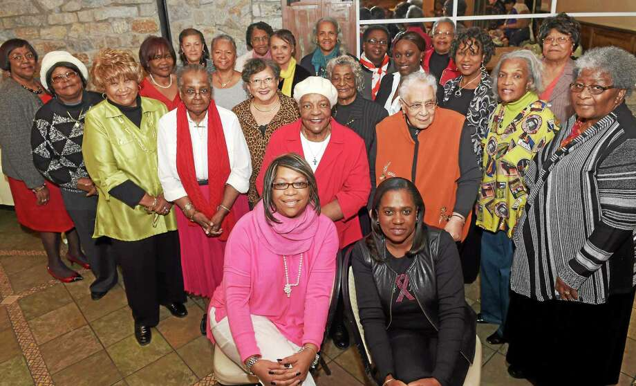 Breast cancer survivor Eilleen William-Escaile of Hamden, front left, and other cancer survivors of Sister's Journey, a breast cancer survivor group, with Dawn White-Bracey, front, right, whose mother, also a breast cancer survivor Linda White-Epps, founded Sister's  Journey, during their annual party to host women selected to participate in their 2015 calendar. Photo: (Peter Hvizdak — New Haven Register)   / ©2014 Peter Hvizdak