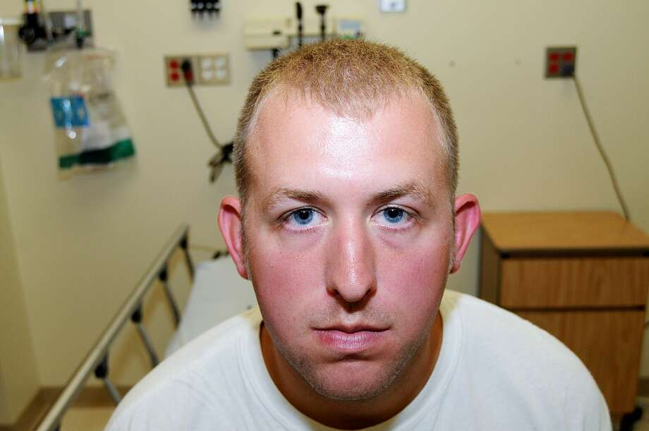 FILE- This undated file photo released by the St. Louis County Prosecuting Attorney's office on Monday, Nov. 24, 2014, shows Ferguson police officer Darren Wilson during his medical examination after he fatally shot Michael Brown, in Ferguson, Mo. Photo: (St. Louis County Prosecuting Attorney's Office) / St. Louis County Prosecuting Attorney's Office