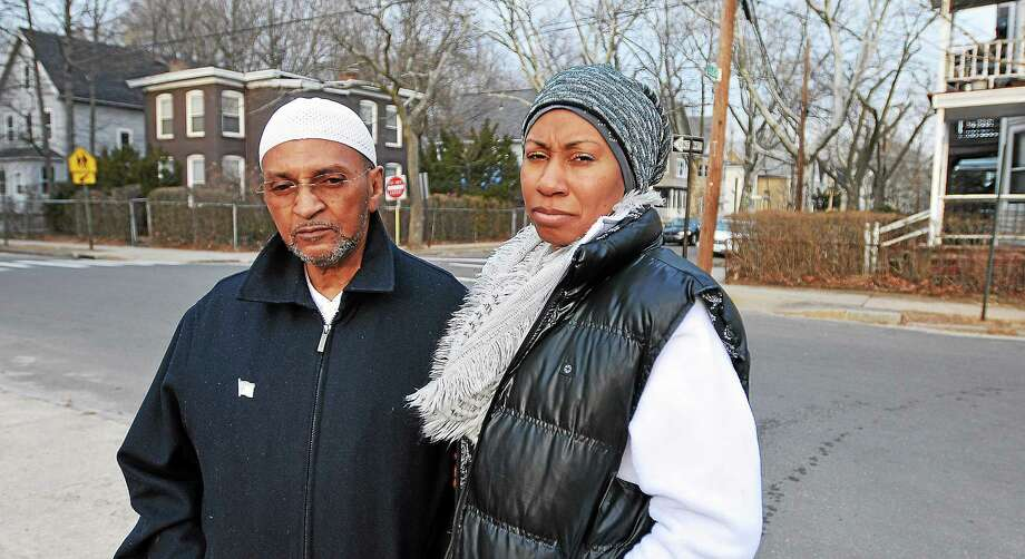 (Peter Casolino-New Haven Register)  Abdul-Karim Sharif and his wife, Tahirah Sharig. have lived on Butler Street for 13 years. They saw the shooting death of Taijhon Washington last week on this spot. Photo: Journal Register Co.