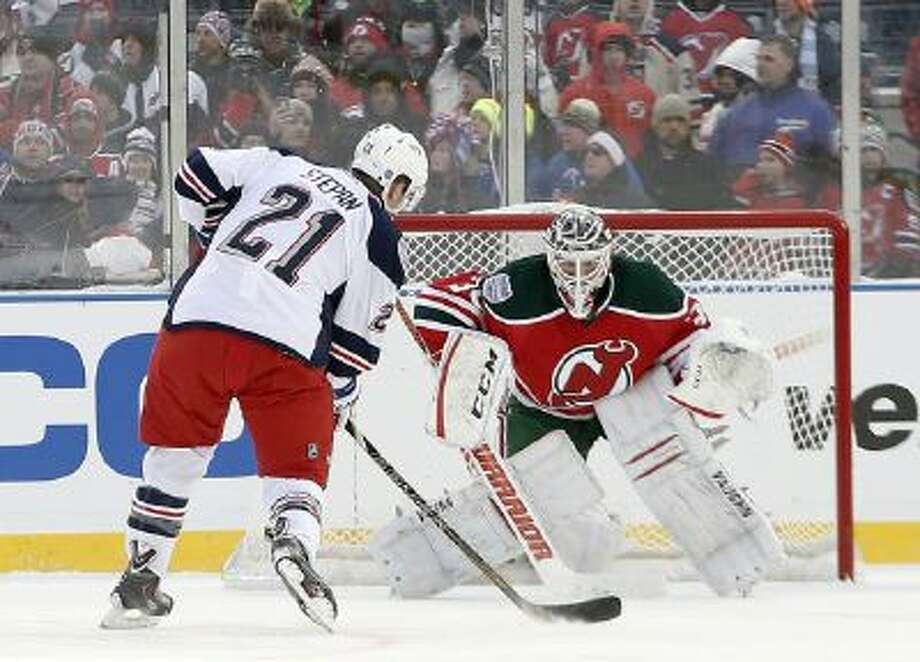 New York Rangers center Derek Stepan (21) takes a penalty shot against New Jersey Devils goalie Martin Brodeur (30) in the third period of the Stadium Series game played at Yankee Stadium Jan. 26.