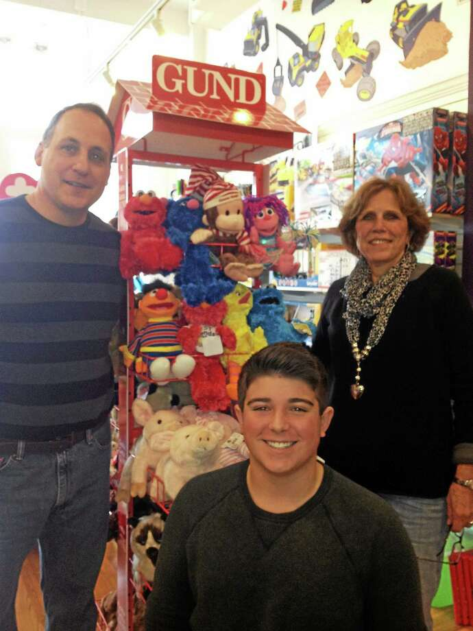 Toy Time owner Tom Giaimo, Cole Chase-Beach and Marge Mehlinger in Branford. Photo: (Mary O'Leary — New Haven Register)