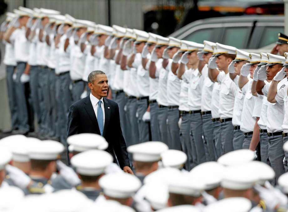 """President Barack Obama arrives to a graduation and commissioning ceremony at the U.S. Military Academy on Wednesday, May 28, 2014, in West Point, N.Y. In a broad defense of his foreign policy, the president declared  that the U.S. remains the world's most indispensable nation, even after a """"long season of war,"""" but argued for restraint before embarking on more military adventures. (AP Photo/Mike Groll) Photo: AP / AP"""