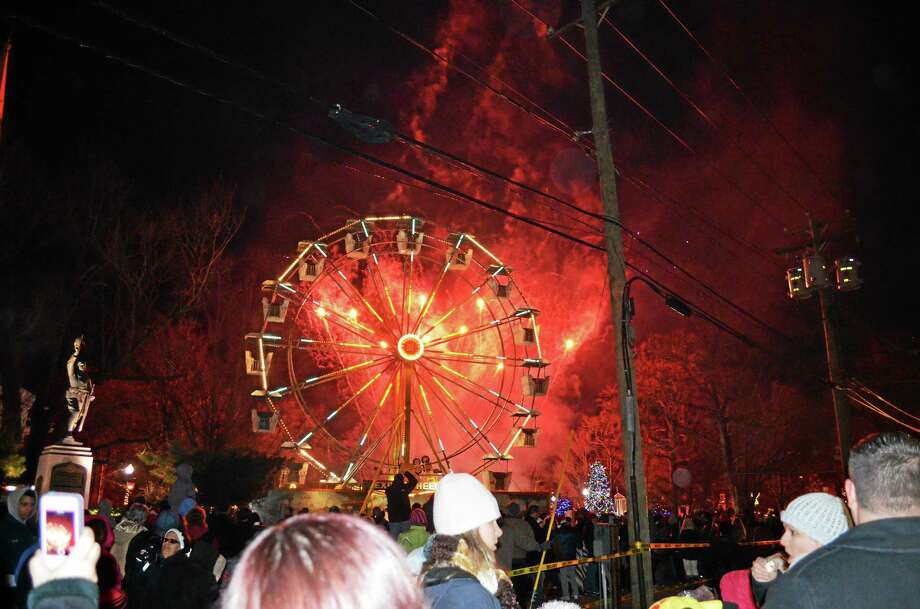 Fireworks light up the sky behind the Ferris wheel during Saturday's tree-lighting ceremony on the West Haven Green. Photo: (Contributed — Michael P. Walsh)
